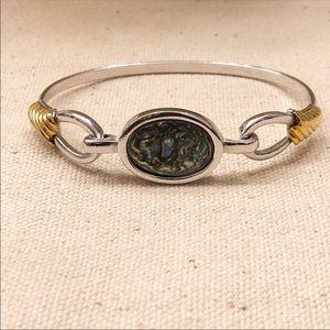 Avon silver and gold tone bangle bracelet